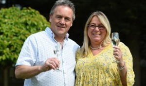 Lottery winners mow celebratory champagne bottle and glasses into their garden