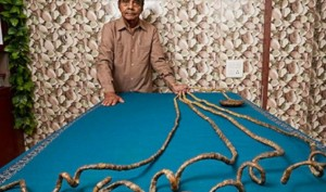Indian man with Guinness World Record of longest nails cuts them after 66 years. Watch video